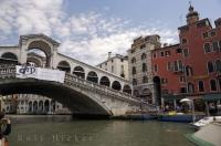 The Rialto Bridge in Venice, Italy is the oldest bridge that crosses the Grand Canal.