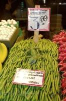 Fresh green beans on display at the Pike Market Public Market Center in Seattle, Washington, USA.