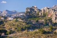The landscape of the town of Guadalest where the ruins of the Castle of Guadalest in Comunidad Valenciana, Spain adorns the region.
