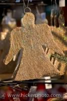 This hanging angel christmas tree ornament was for sale at the christmas markets in the town of Erbach in the state of Hessen in the Odenwald area of Germany. Hanging christmas tree ornaments of all kinds can be found in the christmas markets.