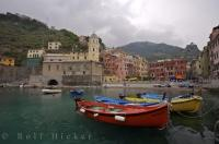 A view of the harbour of the village of Vernazza in Liguria, Italy as rain threatening clouds hang atop the hillsides.