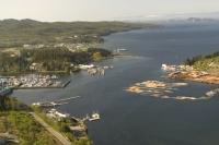 The town site of Port Hardy with bustling Hardy Bay in the foreground looking north towards Queen Charlotte Strait on the coast of British Columbia.