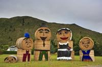 A family of hay bales stand along the roadside in the town of Kurow in the Waitaki Valley in North Otago, New Zealand.