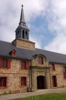 The bell tower adorns the historic building at the King's Bastion at the Fortress of Louisbourg in Nova Scotia, Canada.