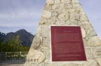 A plaque stands on the shores of the Fraser River and explains the history of Fort Hope in British Columbia, Canada.