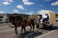 Horse drawn wagons make their way through the town of Roxburgh in Central Otago, New Zealand as a fund raising event for Westpac Helicopter Rescue.