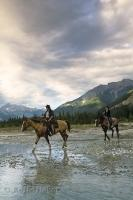 Cloudy days over the Blaeberry Valley in Golden, British Columbia are ideal for horse riding adventures.