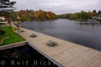 Along the waterfront in the town of Huntsville in Muskoka, Ontario, you can enjoy the beautiful fall scenery from the picnic tables set up along the boardwalk.