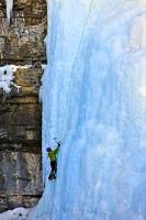 Ice climbing is a popular activity in Canada, and this ice climber is slowly making their way up this sheet of ice in the Upper Falls of the Johnston Creek. This is part of Banff National Park, which is part of the Rockies Mountains.