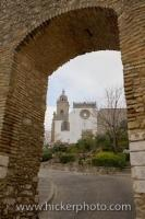 The Iglesia de la Santa Maria la Coronada, a church in the town of Medina Sidonia in the Province of Cadiz in Andalusia, Spain, can be seen in the background beyond the stone archway, and is just a short walk past this point.