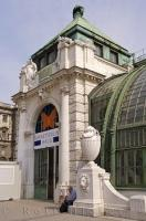Under the statues and unique architecture of this building you will find the entrance to the Imperial Butterfly House in Vienna, Austria.