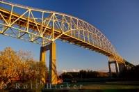 The International Bridge spans the St Mary's River from Sault Ste Marie Ontairo to Sault Ste Marie Michigan. This picture was taken from the viewpoint of Soo Locks that run under the bridge in Ontario Canada.