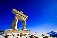 A large stone Inukshuk stands tall and proud atop Whistler Mountain in Whistler, British Columbia. The Inukshuk is what inspired the Ilanaaq, the emblem for the Vancouver 2010 Olympic Winter Games taking place in Whistler and Vancouver in 2010.