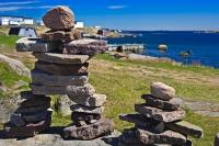 A display of Inukshuks on the shores of Red Bay along the Labrador Coastal Drive in Southern Labrador, Canada.