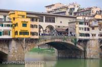 A historic Italian bridge which displays architecture dating back to 1345, spans the Arno River in the City of Florence in the Region of Tuscany in Italy, Europe.