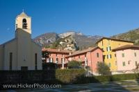 In the small Italian resort town of Torbole, colorful buildings make up resident's homes while the church stands proud in softer hues.