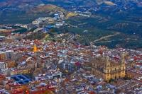As dusk starts to move in over the city of Jaen in Andalucia, Spain, the streets and buildings will start to illuminate the area.