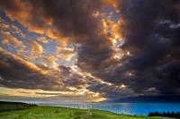 Fascinating cloud formations of extraordinary hues fill the sky at sunset over South Bay and the Kaikoura Coast on the South Island of New Zealand.