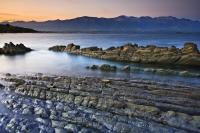 Visiting Kaikoura Peninsula in Canterbury on the South Island of New Zealand at sunset is a breathtaking experience if you like beautiful scenery and wildlife.