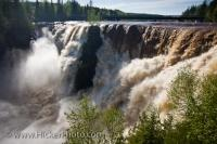 The raging flood waters of the Kaministiquia River career over the Kakabeka Falls after heavy spring rain. The Kakabeka Falls Provincial Park is situated approximately 25 kilometres west of Thunder Bay, Ontario, Canada.