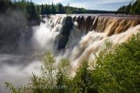 The Kakabeka Falls, also known as the Niagara of the North, is part of the Kaministiquia River and during a spring flood such as in the time this photo was taken it is swollen and much higher than usual.