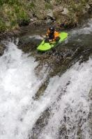 A thrill seeker kayaking over the brink of the waterfall Sauth deth Pish in the Val d'Aran, Catalonia, Spain.