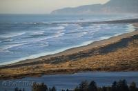 The long stretches of sandy beach along the breakers near Kincheloe Point in Oregon are popular for crabbing and fishing.