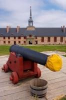 A cannon gun guards the King's Bastion at the Fortress of Louisbourg, a National Historic Site in Nova Scotia, Canada.
