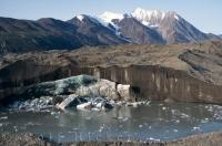 A massive glacier blankets the landscape in Kluane National Park in the Yukon Territory where large pieces of ice are continuously breaking away and gradually melting.