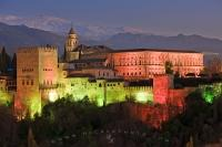 Standing solid on its narrow plateau fortified on every side, La Alhambra is a monumental complex overlooking the city of Granada in the Andalusia region of Spain.