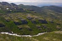 Nestled between glacier carved rocks, a waterfall makes its way down the Mealy Mountains in Southern Labrador, Canada.