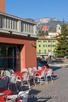 Red and white chairs outside a restaurant along the waterfront of Lake Garda in the town of Torbole in the Province of Trento, Italy.