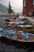 Boats moored in the town of Torbole on Lake Garda in the pristine region of Trentino-Alto Adige, Italy.