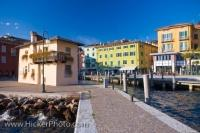The waterfront along Garda Lake in the town of Torbole, Italy is picturesque as the colorful buildings boldly stand out as you walk along the lakeshore.