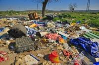 A sad sight while driving through the otherwise pretty green countryside in the province of Jaen - land pollution created through the careless dumping of household garbage along the side of a road.