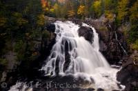 Along the Riviere due Diable in Parc national du Mont Tremblant in Quebec, Canada, the waterfalls are beautiful as they cascade over the landscape while the Autumn forest surrounds them.