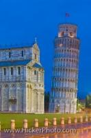 The Leaning Tower of Pisa is lit up at dusk in the town of Pisa in the Tuscany, Italy. Beside the famous Italian monument is the Pisa Duomo and both are located in the Piazza del Duomo (Campo dei Miracoli), which is a UNESCO World Heritage Site.