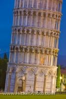 From this angle you can clearly see how the famous Leaning Tower of Pisa received its name. The beautiful architecture of the tower is lit up at dusk in the Piazza del Duomo, also known as the Campo dei Miracoli, located in the city and province of Pisa.