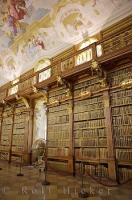 Wooden shelves of historic books fill up the walls of the library at the Stift Melk in Austria, Europe.