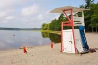 A lifeguard chair on the sandy beach of Kejimkujik Lake in Kejimkujik National Park in Nova Scotia, Canada waiting for the lifeguard to report for duty.