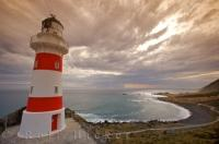 The scenery from the Cape Palliser Lighthouse is stunning as the cloud formations swirl above the coastal regions of Wairarapa on the North Island of New Zealand.