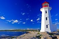 On the shores of the small fishing village of Peggy's Cove in Nova Scotia, Canada is the well known Peggy's Cove Lighthouse or Peggy's Point Lighthouse.
