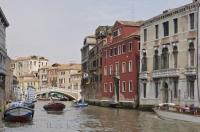 One of the many little or side canals which form a network of waterways through the city of Venice, Italy.