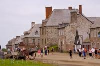 Historic buildings dating back to the eighteenth century, line the Quay at the Fortress of Louisbourg in Cape Breton, Nova Scotia in Canada.