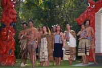 A group photo taken of the Maori people at the Wairakei Terraces near Taupo on the North Island of New Zealand.