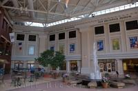 The interior of Market Square in Saint John, New Brunswick where there are shops, a museum and beautiful decor such as the fountain.