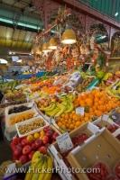 A food market stall at the Central Markets in the City of Florence in Tuscany, Italy displaying a wide selection of fruits and vegetables.