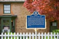 When visitors come to the town of Niagara-on-the-Lake in Ontario, Canada, they can learn a lot about the McFarland House from the blue information sign.