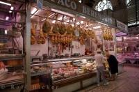 For meat lovers, this picture is a dream come true as legs of ham that have been marked down hang from the roof at this market stall at Mercado Central in Valencia, Spain.