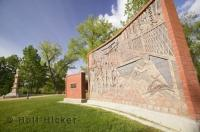 Riverside Park in the heart of Medicine Hat in Alberta, Canada features a brick mural which depicts the history of the area.